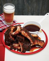Rubbing ribs with a seasoned beer-based mop then cooking them in a foil packet ensures the meat is flavorful and moist.