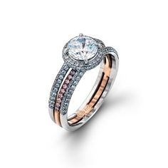 This unique 18 karat rose and white gold engagement ring features .48ctw round white diamonds and .10ctw round pink diamonds. Most rings can be designed to hold any size diamond or gemstone, contact us for specific pricing and more information