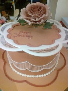 Bronze award winner.  Royal Icing extension work and collar with a sugar rose.