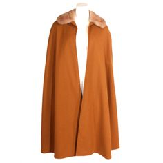 Yves Saint Laurent Cape   From a collection of rare vintage coats and outerwear at http://www.1stdibs.com/fashion/clothing/coats-outerwear/