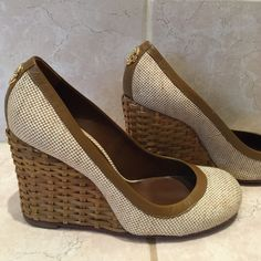 Tory Burch wedges size 7 Very comfortable summer wedge! The shoe is fabric and the heel is woven wicker. Besides the wear on the bottom soles they look brand new! Tory Burch Shoes Wedges