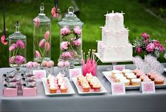 {Reception} Set up your cake and cupcakes to look more enticing (if that's possible). Flowers in apothocary jars complete the look.