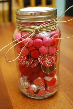 Easy DIY Valentines day gift I made for my boyfriend, all you need to do is take a mason jar and fill it with different layers of red/pink candy or chocolate.