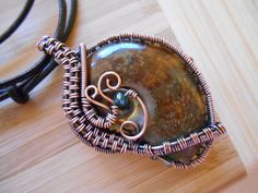 Brown Rust Ammonite Pendant with Blue Glass Crystal beads Wire Wrapped in Oxidized Copper from OurFrontYard Etsy Shop