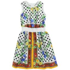 D:Black, white, yellow and red printed dress made of fine viscose fabric. Sleeveless dress without lining. Stretch ribbed neckline, shoulders and waistband. Zipper at the back. Machine washable at 30°C.