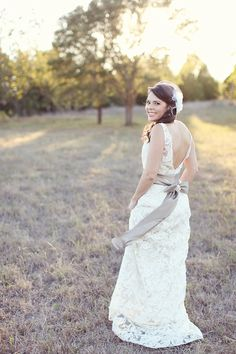 Lace wedding dress from Jim Hjelm   Photo by Forever Photography
