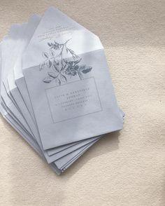 Custom floral envelope calligraphy and addressing on blue envelopes for a summer garden wedding • paula lee calligraphy • paulaleecalligraphy.com