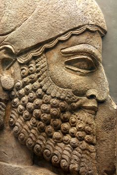 Assyrian Empire. This head of a man comes from a figure in a procession of tribute-bearers. The turban on his head and the style of his hair and beard identify him as someone from the west of the empire, probably the Syrian coast or Turkey. 710-705 BCE. From the Palace of Sargon II, Khorsabad, Iraq.