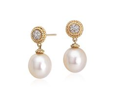 These freshwater cultured pearl drop earrings, showcase a fun twisted rope detailing around a diamond.