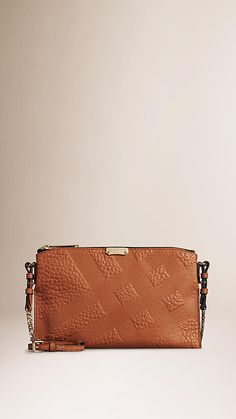Embossed Check Leather Clutch Bag | Burberry saved by #ShoppingIS