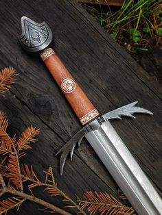 Cedarlore Forge The Stags Strength sword- now working on its matching leather-wrapped scabbard. // The pommel features the customers family crest, and carved motifs of summer leaves and acorns in the antler inlays.