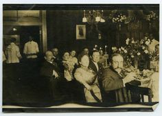 Bernard Cone with others in formal attire during a holiday dinner, circa 1900.