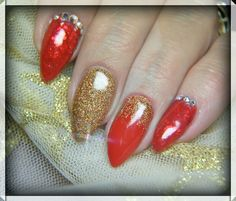 My lovely Christmas nails.  Red Revenge , Red Carpet and Glam Rock Glitter . Not forgetting my trademark gems