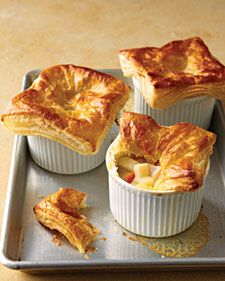 Rustic potpie turns into an elegant meal when baked in individual ramekins. Top each one with a square of purchased puff pastry and bake until golden, crisp, and piping hot.