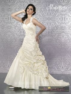 Marys Bridal Bridal Gown Style S13-3Y242 - Strapless, shimmering tulle ball gown with basque waist, sweetheart neckline, corset bodice, re-embroidered lace, metallic embroidery, beads, sequins and crystals. Features detachable sleeves, bustled skirt, keyhole back and lace-up back. Bolero included.