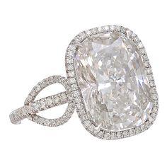 Extraordinary Cushion Cut 7.10 carat Diamond Ring with Tiny Micro Pavé Diamonds Surrounding the Ornament