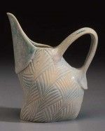 Ceramic pitcher, carved at leather hard, by Silvie Granatelli.