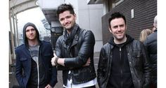 Danny O'Donoghue really rocks a biker leather jacket and oversized scarf for a 90's grunge style.