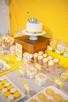 {PARTY FEATURE} Sunny Yellow and Grey Elephant Themed Baby Shower by Lil Miss Macaron. Another clever yellow/grey combination with baby elephants, and great use of wrapping paper as a background for the wall and on the table!