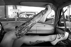 Leg tattoos in an old car