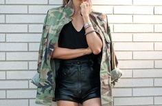 The Haute Pursuit wearing second hand camouflage jacket, T by Alexander Wang tank top, vintage leather shorts.
