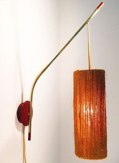 Beautiful sconce by danish designer Ib Fabiansen 1950. Ib Fabiansen did design and produced from his own work studio - lot of his designs are limited to a low number of items. You will probably not see anything like this. Embellished with woven paper this shade gives a cozy light. Together with the teak base and brass stem, this light is a real danish modern piece of design. Teak details to the end of the stem as well. Condition: beautiful patinated with few signs to the brass stem. Ligh...