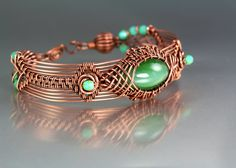 "Copper prototype bracelet by Lisa Barth.  The artist writes: ""I combined many techniques for this one.  I am writing a book on wire work and this will be included."""