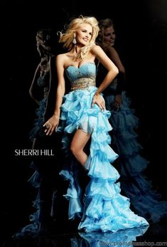 Sherri Hill 3835 at Prom Dress Shop.. with some cowgirl boots would look nice. especially if the dress was a light pink, like in their magazine