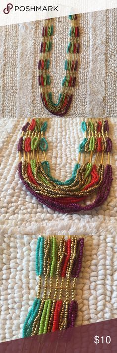 Long Multi-strand Colorful Necklace Long multi strand colorful necklace. Never been worn. Adjustable. Jewelry Necklaces