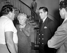 """Director Archie L. Mayo, Dame May Whitty and Tyrone Power between scenes of """"Crash Dive"""", 1943."""