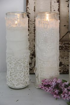 beautiful lace covered candles.or vases.
