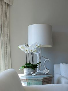 moroccan side table with natural lamp and orchids
