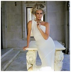 Carmen wearing a white one-shoulder dress by Frank Masandrea, San Simeon, Hearst Castle, Town & Country magazine, 1981