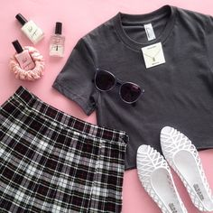 Crop tops + mini skirts in pinks and greys. American Apparel