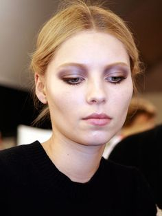 """Valentino Fall 2012 - """"The focus was on dramatic contoured eyes, which McGrath created with various shades of gray and a few shades of brown and lilac, plus """"tons of mascara, top and bottom."""" She also highlighted the lids and combed and filled in the brows for a groomed look."""""""