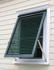 Image result for storm shutters for basement windows