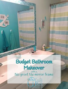Budget bathroom makeover with a no-grout tile frame on the mirror and nautical theme