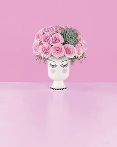 """Bea & the Lady- There's nothing more disarming than an elegant woman with a sparkling wit. This whimsical bouquet pairs our vintage-inspired vase with a coiffure of fragrant, feminine Pink O'Hara Garden Roses. Wisps of Asparagus Fern soften the lines between arrangement and vase, and the """"Tippy"""" Succulent adds a playful focal point."""