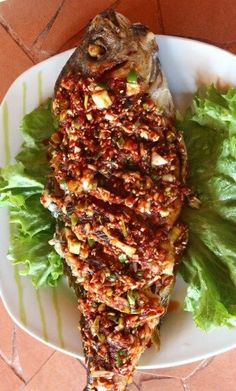 "DOMI YANGNYEOMGUI (deep-fried snapper with seasoning sauce) ~~~ the yangnyeomgui part of the title is the name of the seasoning sauce used in this traditional dish. to paraphrase the write-up, ""while this share uses black snapper, you can make this with red snapper, yellow corvina, pogy, etc. you can also broil, roast, or grill the fish if you don't wish to go for a deep-fry."" [Korea] [maangchi]"