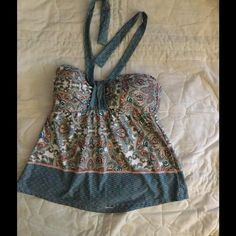 Two piece bathing suit. Very flattering. It ties around the neck and ties in the back. I love it because it hid my puggy stomach. Well I gained weight so my loss and your gain. It's a sm and a C cup. Worn maybe 5 times last summer. ANTONIO MELANI Swim