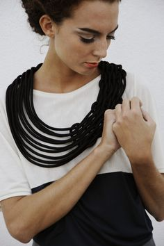 Alienina collection is made with recycled materials: sailing ropes, a special rubber commonly used for cars, cotton wicks for petrol lamps. Necklaces are realized in different colors, from basic black & white to purple, yellow, light blue.