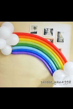 Rainbow Balloon Party Decoration - Long rainbow colored tubular balloons and white round balloons make a great rainbow balloon decoration