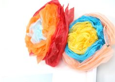 DIY Festive Mexican Paper Tissue Flowers!  Easy craft to do with the kids! Love these :) #DIY #crafts #tutorial