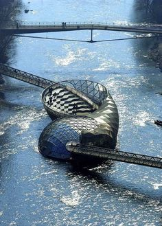 Graz, Austria. Floating coffee shop, I spent almost every weekend here while in Graz! Has an amazing area outside to socialize and suntan too!