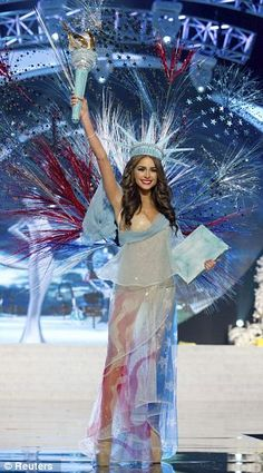 Miss USA (right) dressed up as the Statue of Liberty