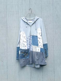reserved for Mindy one of a kind upcycled dress by CreoleSha grab your boots and jeans - sweet but funky little tunic / jacket for work or playing in the city - i chose a mix of up-cycled cottons, knits and denim and pieced it together in a funky kind of way that is very flattering to the body :) *would look great with a pair of wedges / boots and leggings SIZE - Medium - Large Chest - 20 across front lying flat - does stretch Hips - 22 1/2 across front lying flat - no stretch Length...