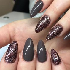 Very attractive almond nails in grey color and rhinestones in color of rotten cherry. It is great for samo glamorous ceremony at which you want to leave the impression of lady with style.