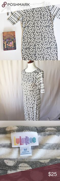 """LuLaRoe Julia Dress Gray Polka Dot Stripe Medium The Julia dress is a form fitting, knee- length, knit dress with mid-length sleeves and a high neckline. It is feminine, flattering, and you may not ever want to take it off. Pattern is gray and white polka dots on front and striped on back.   Fabric: 48% polyester, 36% cotton 12% rayon, 4% spandex   Approximate Measurements: Size: Medium Length: 40"""" Bust: 37""""   Condition: Very Good Used Condition - no flaws but some light wash wear. LuLaRoe…"""