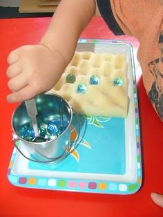 Is that the waffle foam from a mattress pad or  packing foam? I love to re-purpose things. And what child can resist the marbles!.