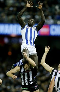 Majak Daw Mark of the Year contender in North Melbourne v Collingwood | Herald Sun